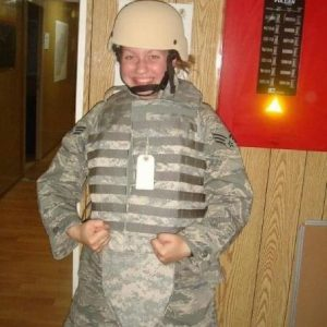 woman in combat uniform smiling