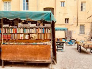 antique books on a cart in an Italian square