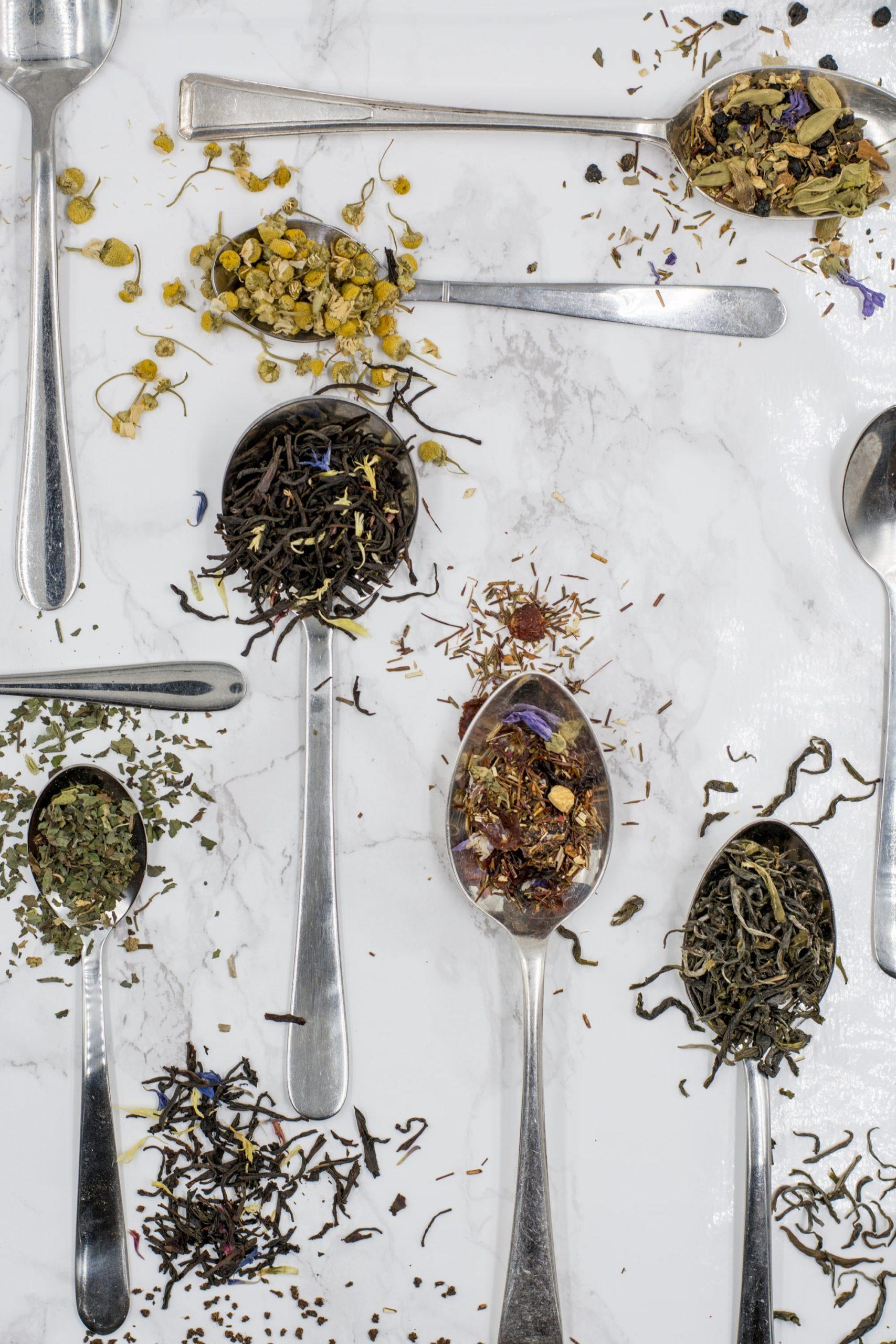 loose leaf tea leaves on spoons