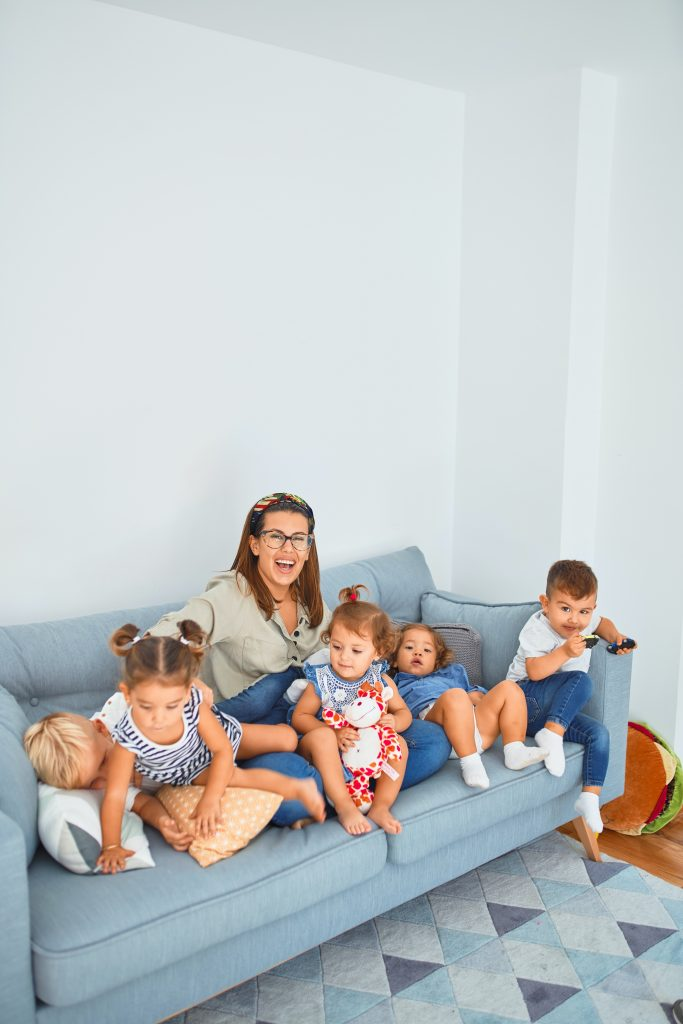 mother with 5 children on a blue couch