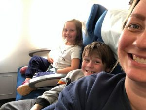 kids and mom on a flight
