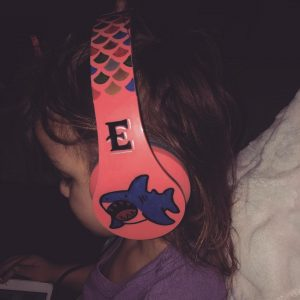young girl with headphones on