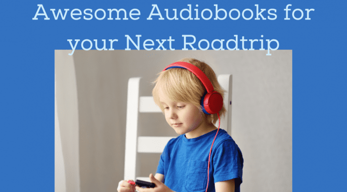 """boy listening with headphones on blue background with """"Awesome Audiobooks for your Next Roadtrip"""" in text"""