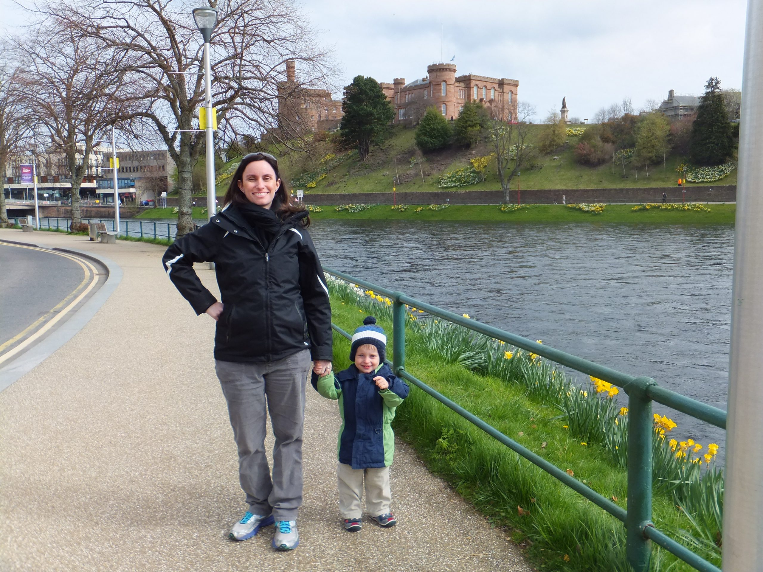 Mother and son in front of lake and castle in Scotland, April 2015
