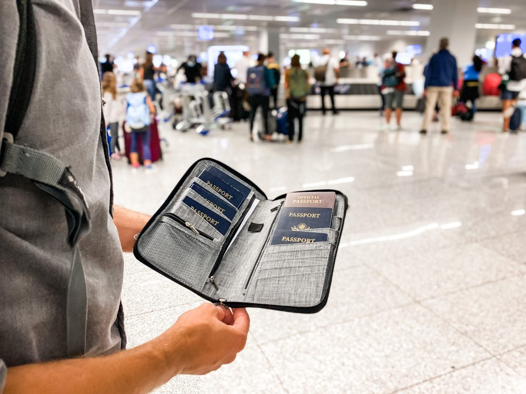 person holding a passport holder in an airport