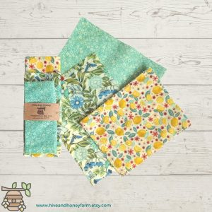 beeswax sustainable wraps in different colors on a wood plank background