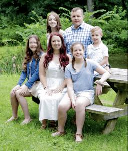 Rachel Carpenter and family outside
