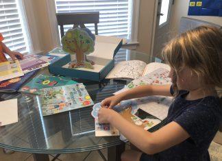 Daughter doing an activity from Hola Amigo Box