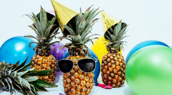 pineapples wearing sunglasses and beach balls