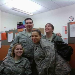 Diana Loader and active duty coworkers in Air Force uniform