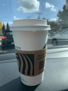 Starbucks coffee on a car dashboard