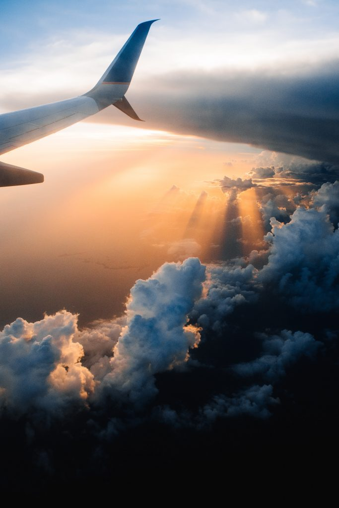 airplane wing in the setting sun skyline